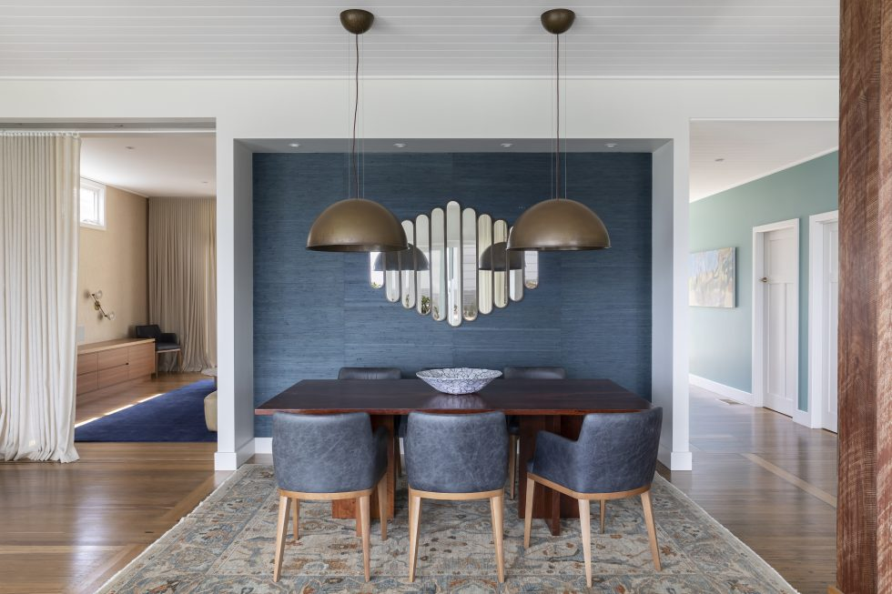 Interior design project in Manly showing the dining room mirror, curtains, dining chairs, table and pendant lights