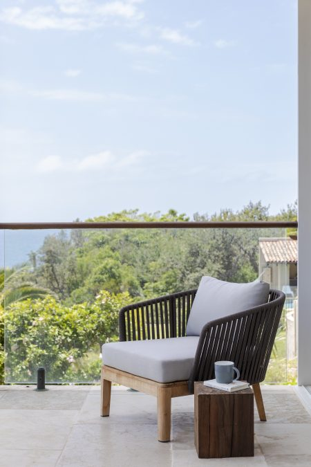 Interior design project in Manly with an outdoor armchair looking out to the view of the Northern Beaches