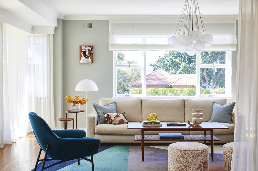 Living Room in Sydney with colourful rug, sheer blinds and cloud pendant light