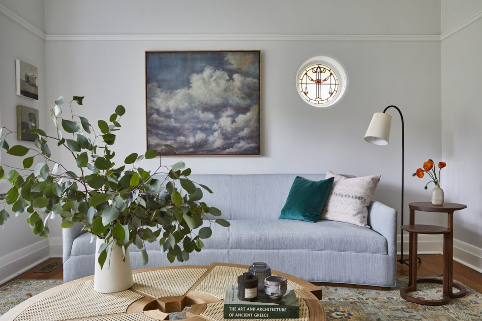A beautiful, light sitting / living room with bay windows with interior design and decoration by Alex Gourlay of Vellum Interiors