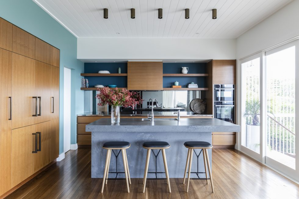 Interior design project in Manly showing a kitchen with timber, blue, aqua and Caesarstone concrete benchtops
